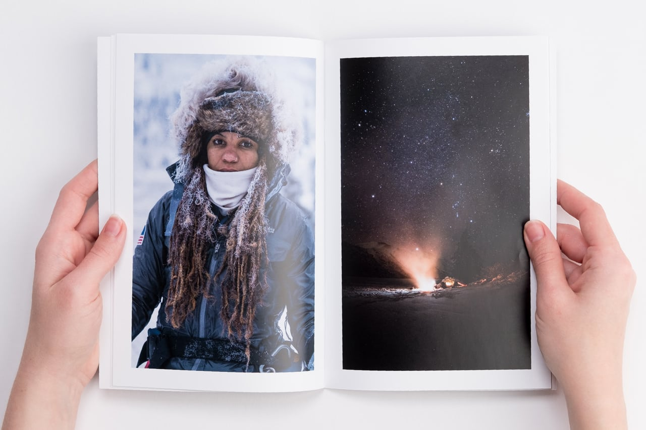 Portrait of hiker on left page and long-exposure photo of campfire and night sky on right page.
